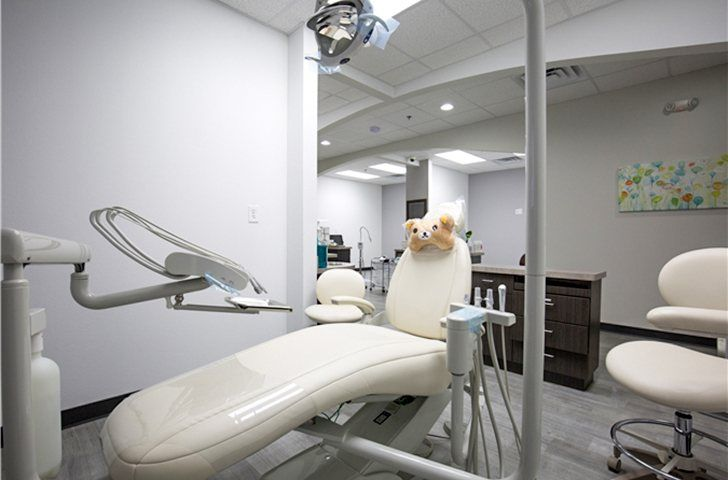 Dental exam chair with kids toy
